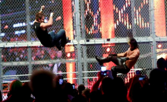 HIAC2014 Ambrose and Rollins fall through the announce desks