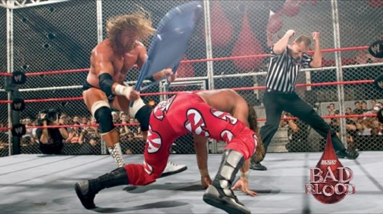 HHH hits Shawn Michaels with a chair